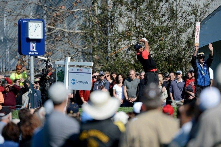 Tiger Woods hits off the 10th tee during the final round at the Farmers Insurance Open on January 28, 2013