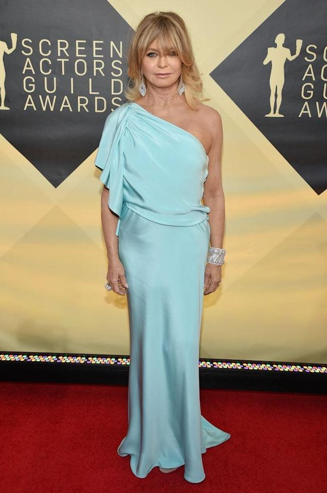 <p>Hawn stunned in a one-shouldered light teal gown. (Photo: Getty Images) </p>