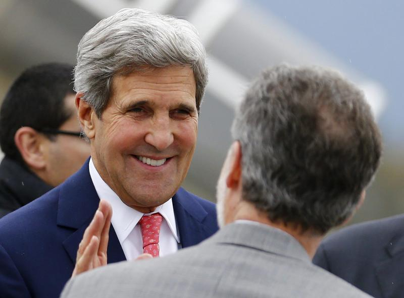 "US Secretary of State John Kerry smiles as he arrives at Geneva International airport, Switzerland Friday Nov. 8, 2013 for closed-door nuclear talks at the United Nations offices. Four world powers are dispatching their top diplomats to Geneva on Friday to add their weight to negotiations aimed at putting initial limits on Iran's ability to make atomic weapons. French, British and German foreign ministers are joining U.S. Secretary of State John Kerry in Geneva, who is coming ""to help narrow differences in negotiations,"" according to a U.S. official who spoke on condition of anonymity because he was not authorized to release the information. (AP Photo//Denis Balibouse,Pool)"