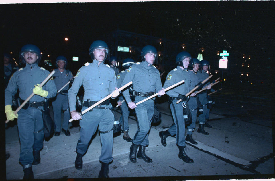 Virginia Beach, Virginia: Scores of police in riot gear prepare to move down Pacific Avenue, (September 4th), during the 2nd night of disturbances by students.