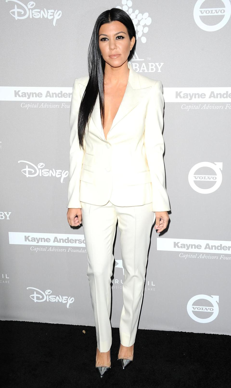 Kourtney Kardashian wowed in another tailored suit. The mum-of-three donned an all-white Dolce & Gabbana look for the occasion, paired with metallic heels. [Photo: Rex]