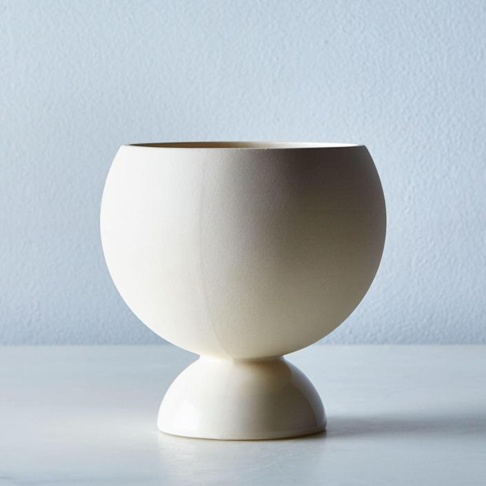 """This minimalist plant stand can also double as a vase for cut flowers. $60, Food52. <a href=""""https://food52.com/shop/products/2862-white-covas-planter"""" rel=""""nofollow noopener"""" target=""""_blank"""" data-ylk=""""slk:Get it now!"""" class=""""link rapid-noclick-resp"""">Get it now!</a>"""