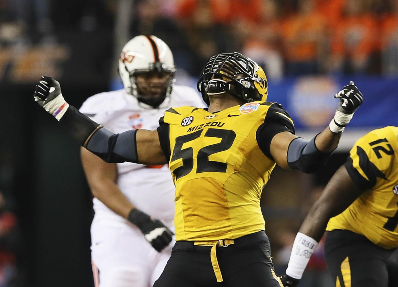 Missouri Tigers defensive lineman Michael Sam (52) reacts after a play during the second half against the Oklahoma State Cowboys in the 2014 Cotton Bowl at AT&T Stadium in Arlington, Texas in this January 13, 2014 file photo. According to media reports, Sam announced publicly he was gay February 9, 2014, paving the way from him to perhaps be the NFL's first openly gay player. Mandatory Credit: Kevin Jairaj-USA TODAY Sports (UNITED STATES - Tags: SPORT FOOTBALL)