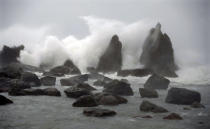 Waves hit Hashiguiiwa Rocks, a scenic spot, in Kushimoto, Wakayama prefecture, central Japan, Friday, Oct. 9, 2020, as Typhoon Chan-hom approaches. A slow-moving typhoon off Japan's southern coast has triggered gusts and rain across a large part of the country and could bring heavy rains to the Tokyo region early next week, though it was not expected to make landfall, officials said Friday.(Kyodo News via AP)