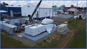 The final module being loaded into position, with the Company's LiSTR DLE Plant behind.  Note the climate-controlled container adjacent to the SiFT Plant, which will be used to store battery-quality lithium carbonate samples produced by the plant.