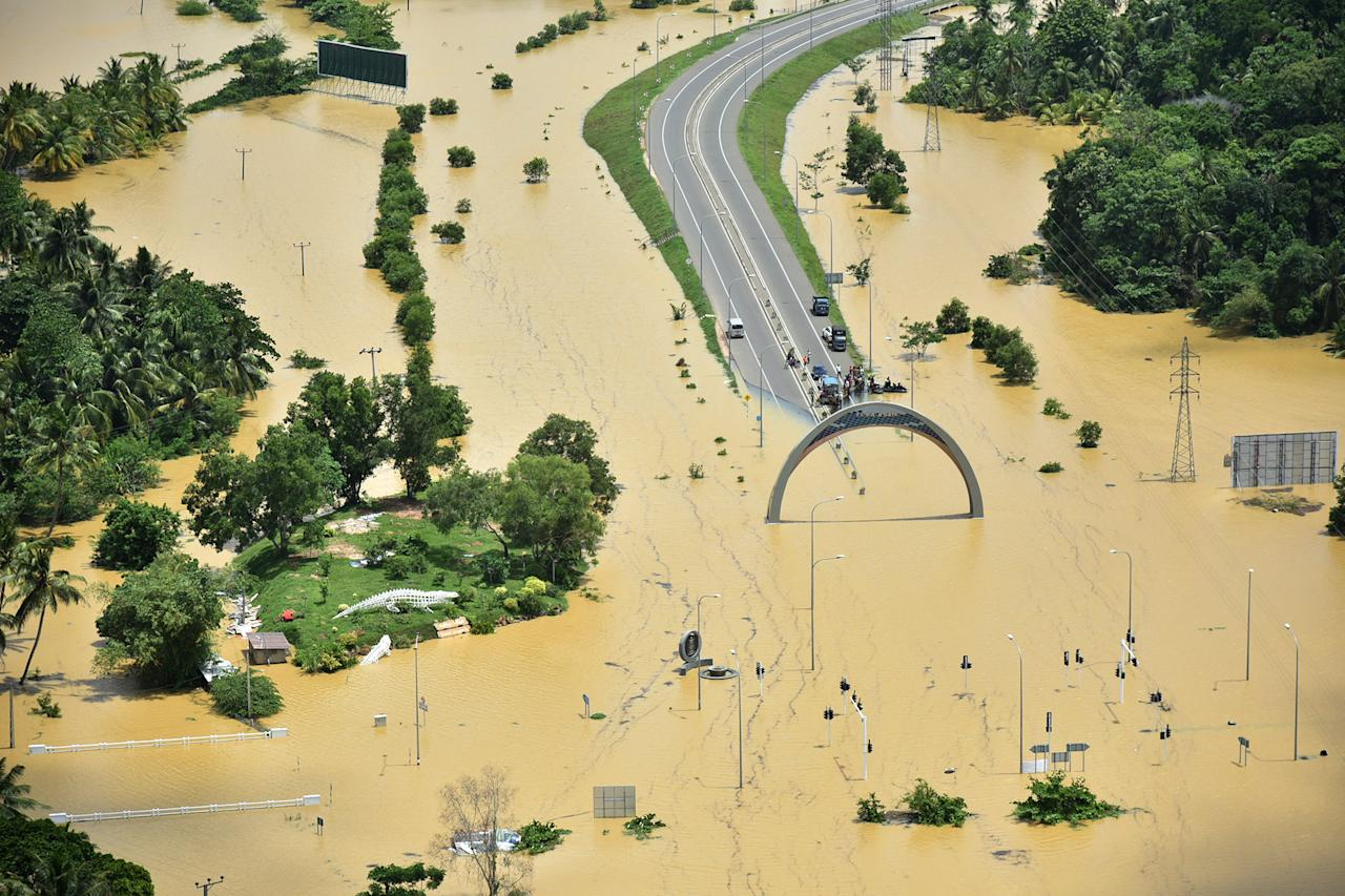 REFILE - CORRECTING BYLINE A part of a flooded highway exit is seen in a village in Matara, Sri Lanka May 29, 2017. Sri Lanka Air Force/Handout via REUTERS ATTENTION EDITORS - THIS IMAGE WAS PROVIDED BY A THIRD PARTY. EDITORIAL USE ONLY. NO RESALES. NO ARCHIVE     TPX IMAGES OF THE DAY