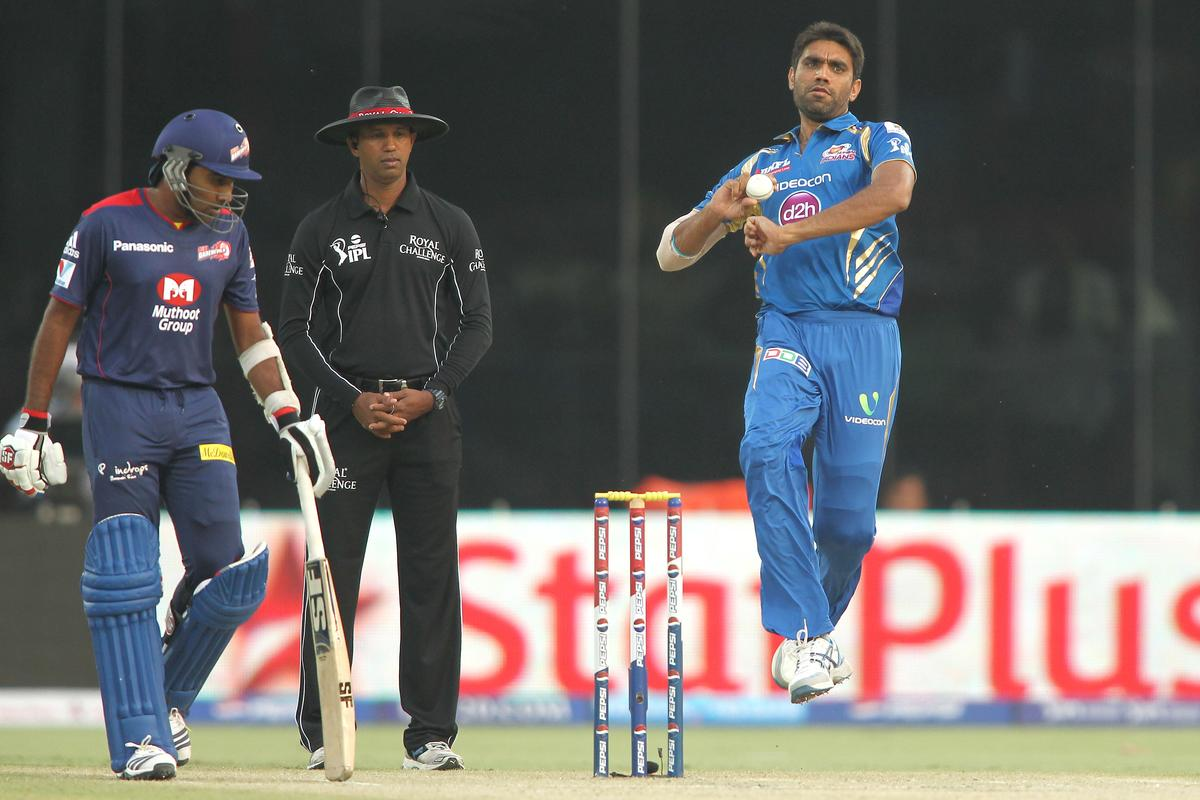 Munaf Patel of Mumbai Indians sends down a delivery during match 28 of the Pepsi Indian Premier League between The Delhi Daredevils and the Mumbai Indians held at the Feroz Shah Kotla Stadium, Delhi on the 21st April 2013. (BCCI)