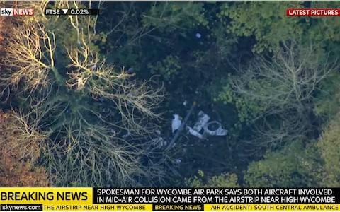 Wreckage from the mid-air crash in woodland at Upper Winchendon - Credit: Sky News/PA