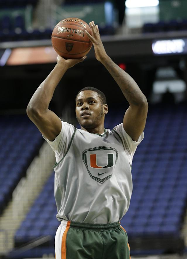Miami's James Kelly takes a shot during an NCAA college basketball practice at the Atlantic Coast Conference tournament in Greensboro, N.C., Tuesday, March 11, 2014. Miami plays against Virginia Tech in a first round game on Wednesday. (AP Photo/Chuck Burton)