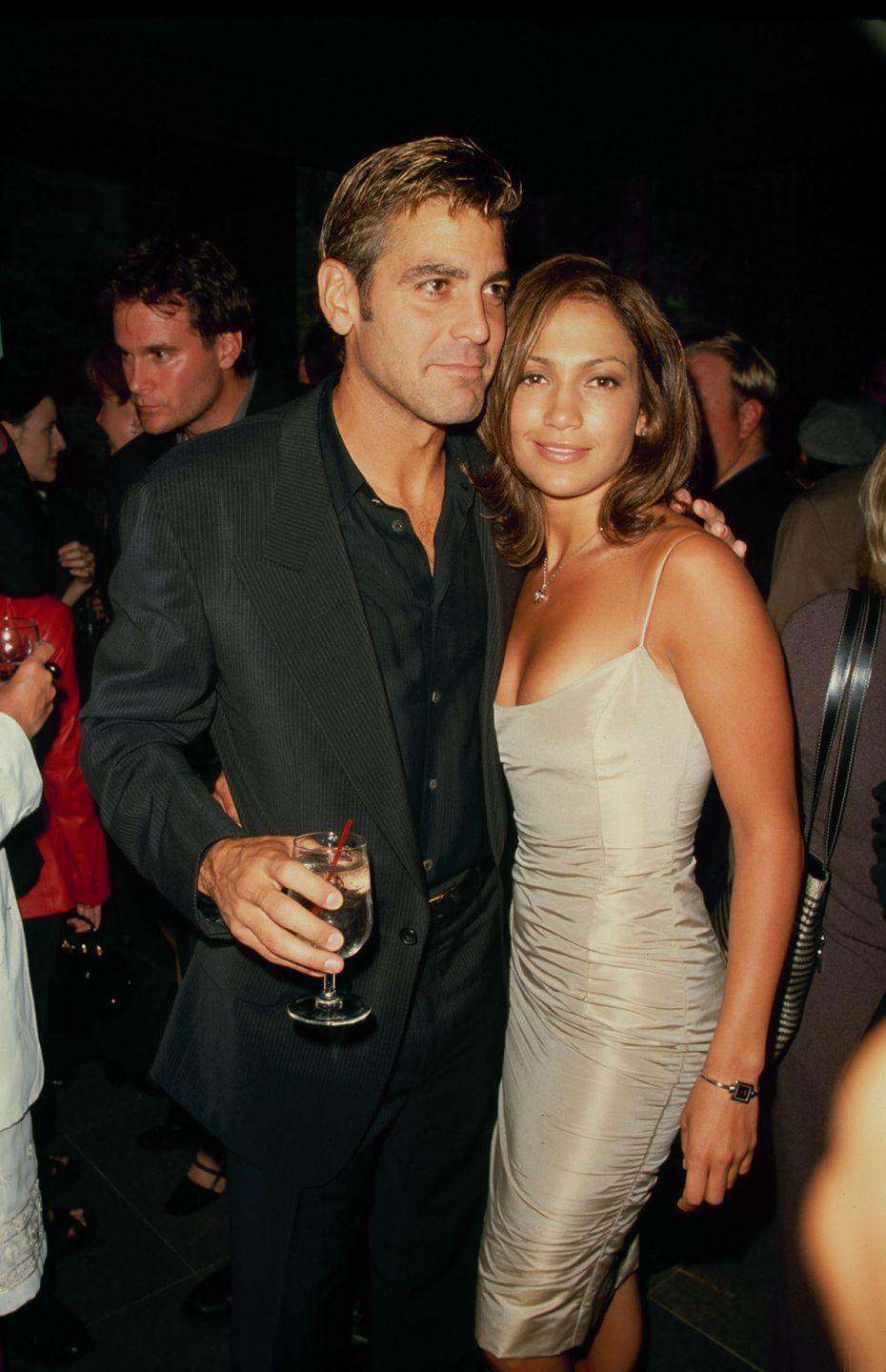 <p>Clooney and Jennifer Lopez at premiere of their film <em>Out Of Sight </em>on June 24, 1998.</p>