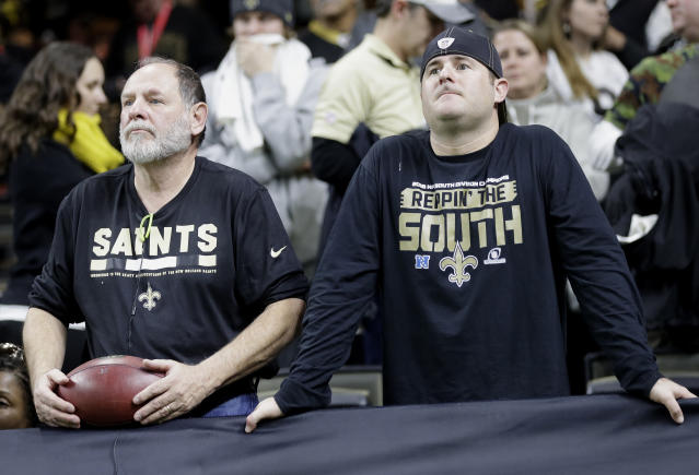 A New Orleans Saints fans are seen after overtime of the NFL football NFC championship game between the New Orleans Saints and the Los Angeles Rams, Sunday, Jan. 20, 2019, in New Orleans. The Rams won 26-23. (AP Photo/Gerald Herbert)