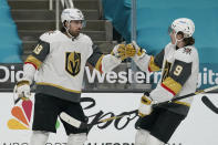 Vegas Golden Knights right wing Alex Tuch, left, is congratulated by center Cody Glass (9) after scoring against the San Jose Sharks during the second period of an NHL hockey game in San Jose, Calif., Saturday, March 6, 2021. (AP Photo/Jeff Chiu)