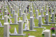 South Korean Oh Eui-sang sits in front of the gravestone of his brother Oh In-sang, who was killed during the Korean War, on Memorial Day at the national cemetery in Seoul, South Korea, Sunday, June 6, 2021. (AP Photo/Lee Jin-man)