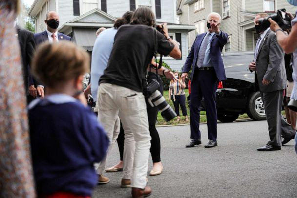 PHOTO: Democratic U.S. presidential candidate and former Vice President Joe Biden waves goodbye after talking to a young local child and news media as he visits the neighborhood where he grew up while campaigning in Scranton, Pa., July 9, 2020. (Tom Brenner/Reuters)