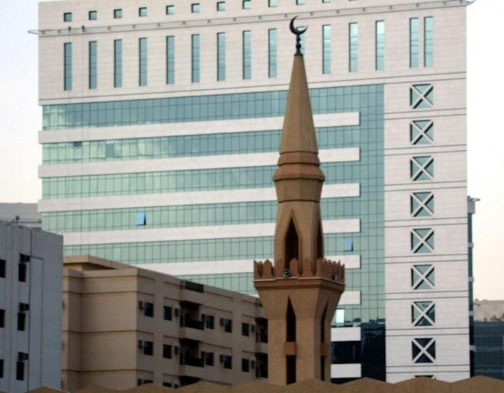 Minaret of a mosque pictured in front of the modern King Faisal Foundation building in the Saudi capital Riyadh
