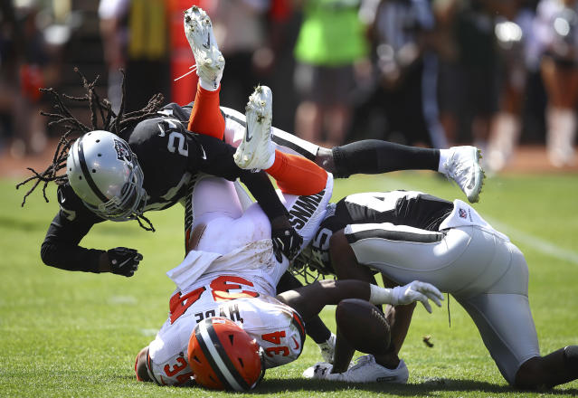 <p>Cleveland Browns running back Carlos Hyde (34) fumbles under Oakland Raiders defensive back Reggie Nelson (27) and defensive back Dominique Rodgers-Cromartie (45) during the first half of an NFL football game in Oakland, Calif., Sunday, Sept. 30, 2018. Hyde recovered the fumble. (AP Photo/Ben Margot) </p>