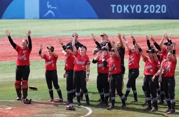 Canada's women's softball team cheers after winning the bronze medal in their game against Mexico at the Tokyo Olympic Games.  (Koji Watanabe/Getty Images - image credit)