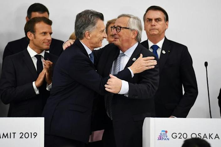 "The EU and the South American trade bloc Mercosur sealed a blockbuster trade deal after 20 years of talks, with EC President Jean-Claude Juncker (2ndR) hailing it as a ""strong message"" in support of ""rules-based trade"" (AFP Photo/Charly TRIBALLEAU)"