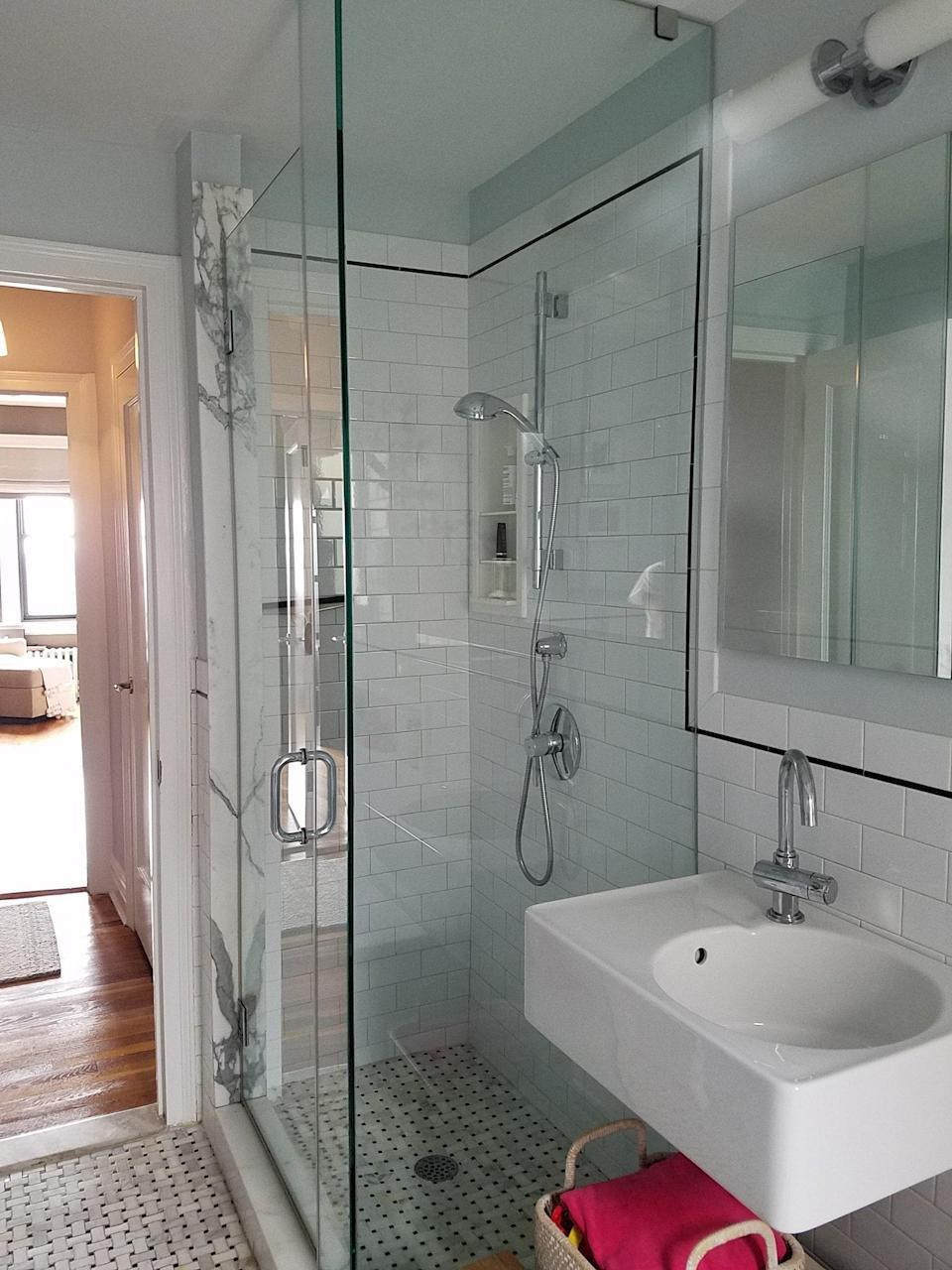"""BEFORE: In this bathroom designed for two young sisters, Frederick Tang Architecture faced some technical challenges, such as the creation of a curbless shower in the prewar building. """"We had to recess the shower pan to achieve the curbless detail,"""" says Frederick Tang, founder, director of design, and principal architect at Frederick Tang Architecture."""