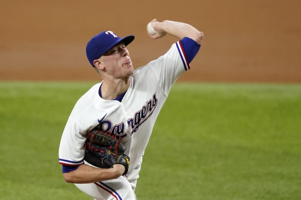 Texas Rangers starting pitcher Kolby Allard throws to the Los Angeles Angels in the third inning of a baseball game in Arlington, Texas, Wednesday, Aug. 4, 2021. (AP Photo/Tony Gutierrez)