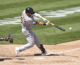 Detroit Tigers' Robbie Grossman (8) hits a single against the Oakland Athletics during the fifth inning of a baseball game on Saturday, April 17, 2021, in Oakland, Calif. (AP Photo/Tony Avelar)