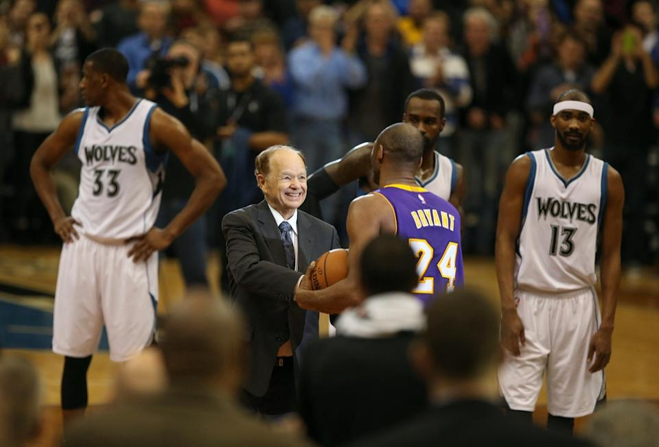 Minnesota Timberwolves owner Glen Taylor presents Kobe Bryant with the game ball after Bryant moved past Michael Jordan on the all-time scorers list on Sunday, Dec. 14, 2014, at the Target Center in Minneapolis.