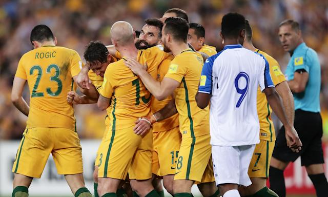 Mile Jedinak celebrates the first of his, and Australia's, goals against Honduras at ANZ Stadium.