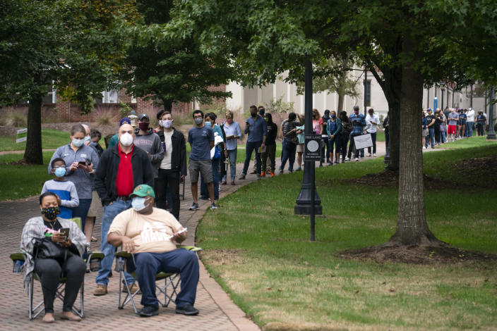 Early voters wait in a long line at a polling place in Decatur, Ga., on Oct. 12, 2020. (Nicole Craine/The New York Times)