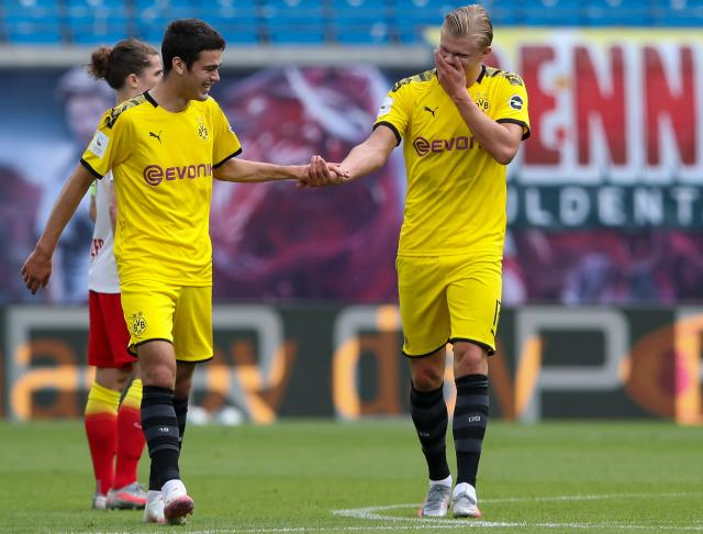 In his first start for Borussia Dortmund, Giovanni Reyna (left) set up Erling Haaland's game-winning goal. (Ronny Hartmann/Getty Images)