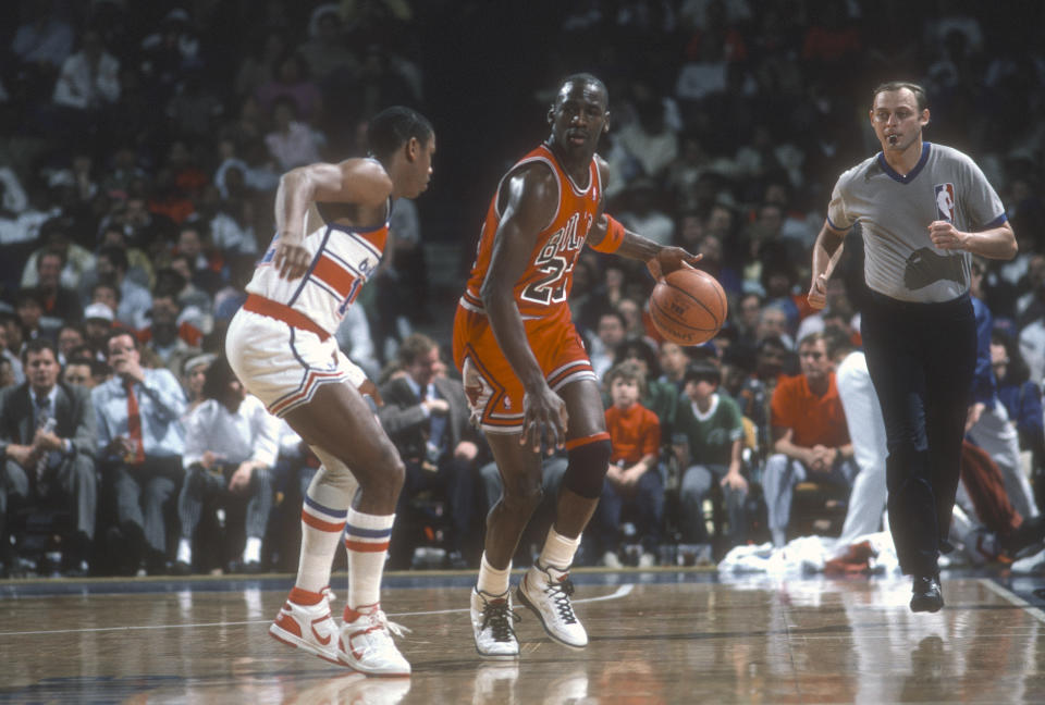LANDOVER, MD - CIRCA 1986: Michael Jordan #23 of the Chicago Bulls dribbles the ball up court against the Washington Bullets during an NBA basketball game circa 1986 at the Capital Centre in Landover, Maryland. Jordan played for the Bulls from 1984-93 and 1995 - 98. (Photo by Focus on Sport/Getty Images) *** Local Caption *** Michael Jordan