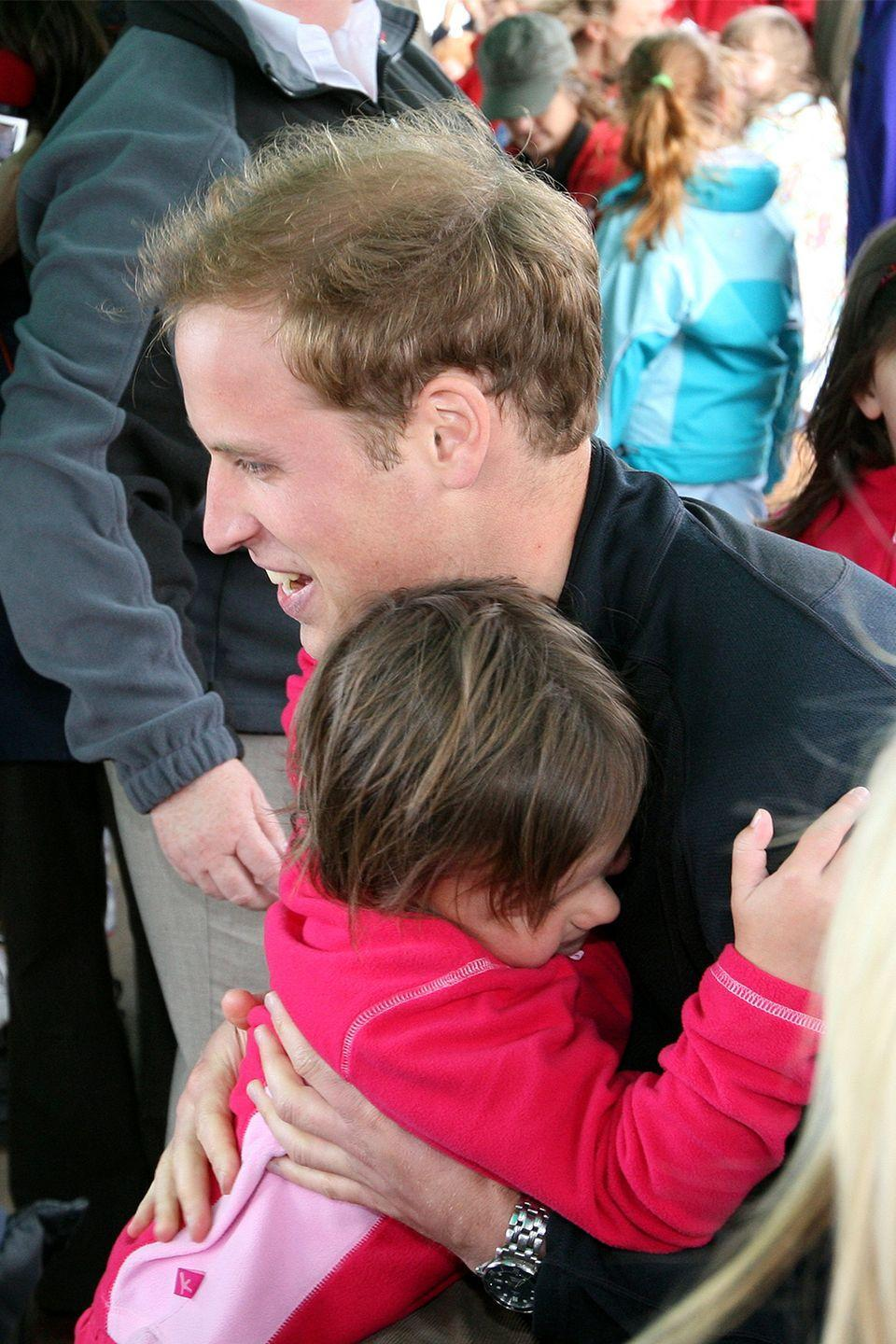 <p>Considering even shaking hands with a royal is prohibited, hugging is definitely off the table. In 2009, Prince William made the cutest exception for a little fan in Ullswater. </p>