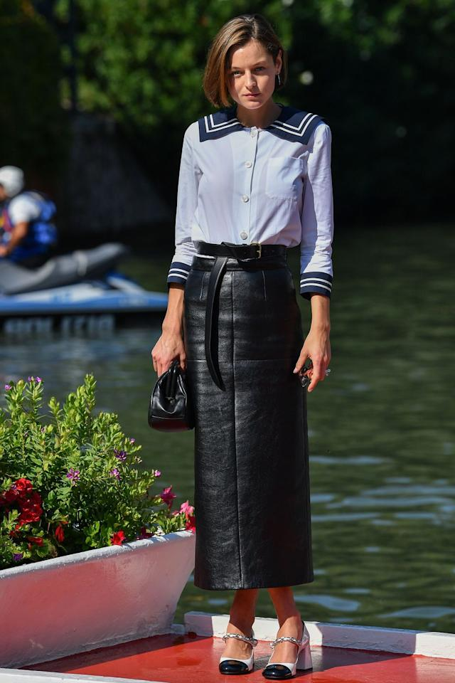 <p><strong>Wearing:</strong> Head-to-toe Miu Miu, complete with a sailor-inspired shirt and a leather midi skirt.</p><p><strong>Where:</strong> Venice Film Festival, September 2020.</p>