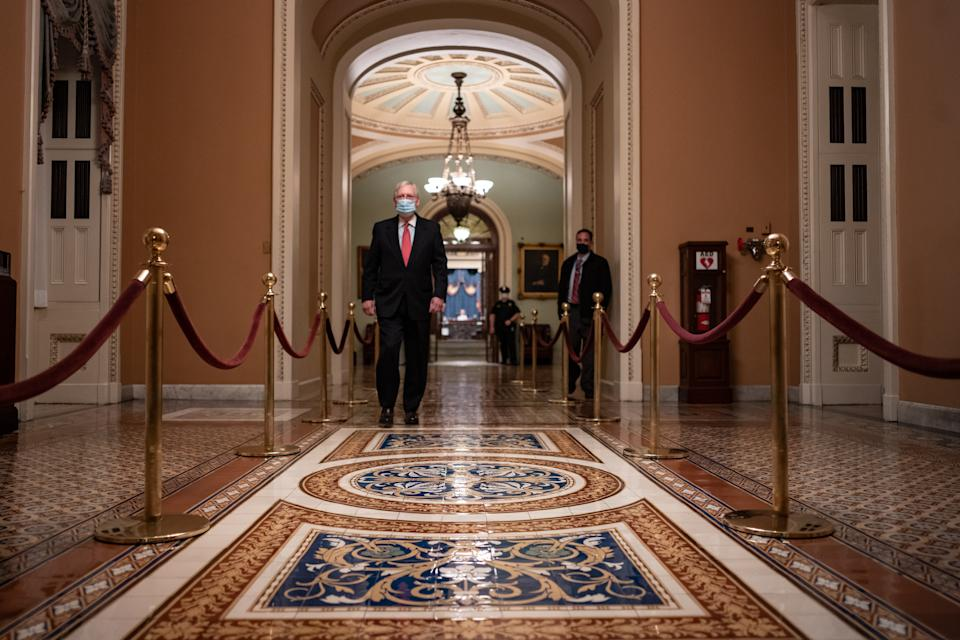 WASHINGTON, DC - DECEMBER 21: Senate Majority Leader Mitch McConnell (R-KY) walks to his office after leaving the Senate Floor at the U.S. Capitol on December 21, 2020 in Washington, DC. The House and Senate are set to vote today on a roughly $900 billion pandemic relief bill to bolster the U.S. economy amid the continued coronavirus pandemic that would be the second-biggest economic rescue measure in the nations history. (Photo by Cheriss May/Getty Images)