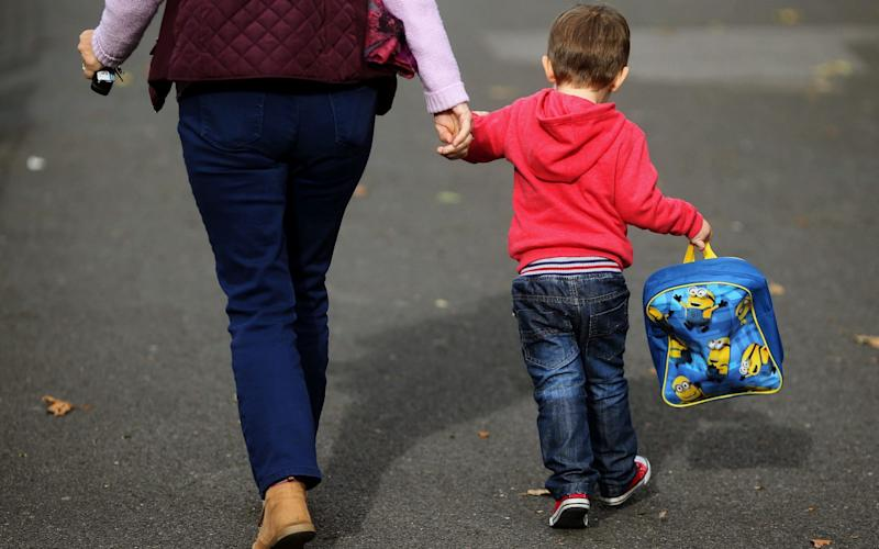 The price of sending a young child to nursery part-time is now £122 a week, according to a new report which says the cost of childcare is soaring - PA