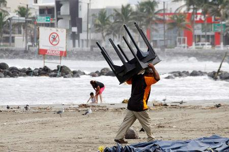 A man carries a table ahead of Hurricane Katia in Veracruz, Mexico, September 7, 2017. REUTERS/Victor Yanez