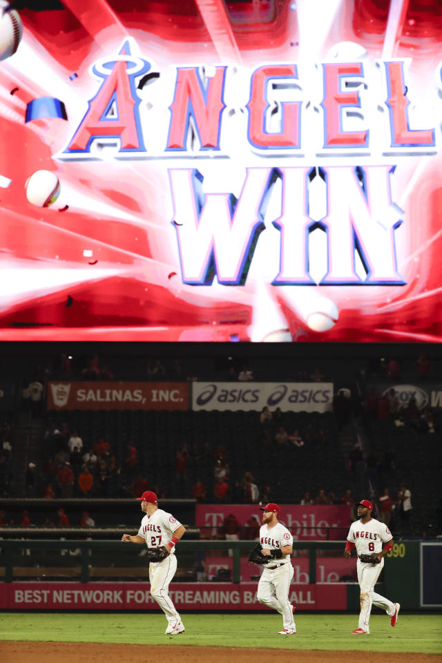 Los Angeles Angels center fielder Mike Trout, from left, right fielder Kole Calhoun and left fielder Justin Upton run off the field after their win against the Texas Rangers during a baseball game in Anaheim, Calif., Tuesday, Sept. 11, 2018. (AP Photo/Chris Carlson)