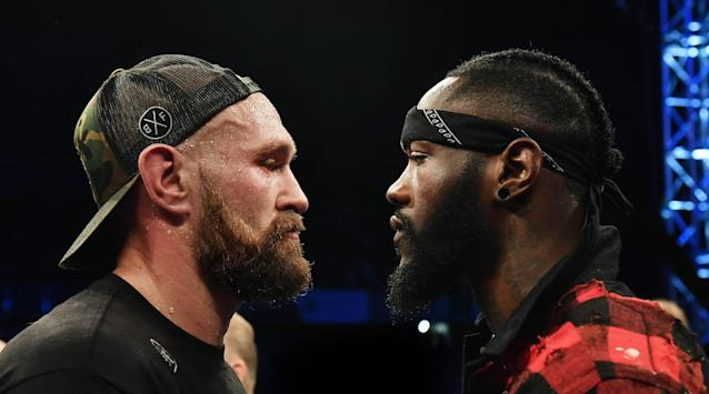 Tyson Fury is confronted by rival boxer Deontay Wilder after defeating Francesco Pianeta in a heavyweight contest at Windsor Park on August 18, 2018 in Belfast, Northern Ireland. (Photo by Charles McQuillan/Getty Images)