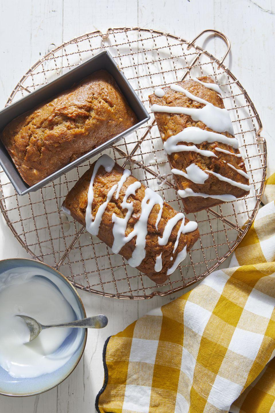 """<p>Know any carrot cake lovers? Make this bread in mini pans and it's perfect for gifting. Or make it in one large pan for yourself.</p><p><strong><a href=""""https://www.countryliving.com/food-drinks/a34946865/carrot-nut-bread-with-sour-cream-glaze-recipe/"""" rel=""""nofollow noopener"""" target=""""_blank"""" data-ylk=""""slk:Get the recipe"""" class=""""link rapid-noclick-resp"""">Get the recipe</a>.</strong></p><p><a class=""""link rapid-noclick-resp"""" href=""""https://www.amazon.com/Chicago-Metallic-Commercial-Non-Stick-Mini/dp/B003YKGQVK/?tag=syn-yahoo-20&ascsubtag=%5Bartid%7C10050.g.35246097%5Bsrc%7Cyahoo-us"""" rel=""""nofollow noopener"""" target=""""_blank"""" data-ylk=""""slk:SHOP MINI LOAF PANS"""">SHOP MINI LOAF PANS</a></p>"""