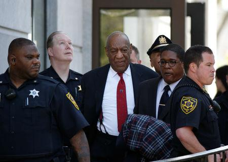 Actor and comedian Bill Cosby exits Montgomery County Courthouse after a jury convicted him in a sexual assault retrial in Norristown, Pennsylvania, U.S., April 26, 2018. REUTERS/Brendan McDermid/Files