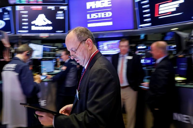 Traders work on the floor at the NYSE in New York