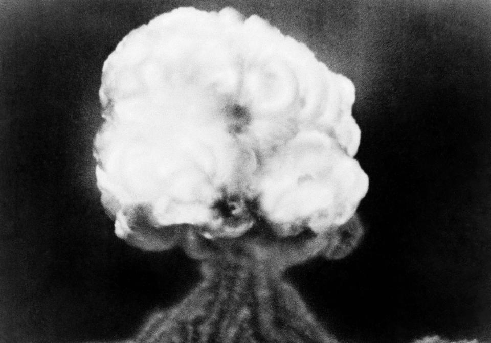 FILE - This July 16, 1945, file photo, shows the mushroom cloud of the first atomic explosion at Trinity Test Site near Alamagordo, N.M. The president of the Navajo Nation and New Mexico residents who lived downwind from the site of the world's first atomic blast are among those seeking recognition and compensation from the U.S. government for people affected by uranium mining and nuclear testing carried out during the Cold War. A congressional subcommittee was taking testimony Wednesday, March 24, 2021, about who should be eligible under the Radiation Exposure Compensation Act. (AP Photo/File)