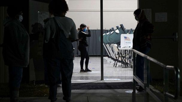 PHOTO: Voters wait outside Victory Houston polling station in Houston, Oct. 30, 2020. The location was one of the Harris County's 24-hour locations.  (Elizabeth Conley/Houston Chronicle via AP)