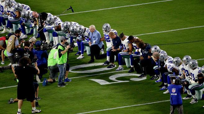 Jerry Jones, who perpetually draws attention to himself and the NFL anthem flap, got caught slipping on protocol before a Cowboys practice. (AP)