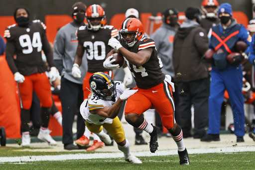 Cleveland Browns running back Nick Chubb (24) breaks a tackle from Pittsburgh Steelers free safety Minkah Fitzpatrick (39) for a 47-yard touchdown during the first half of an NFL football game, Sunday, Jan. 3, 2021, in Cleveland. (AP Photo/Ron Schwane)
