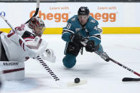 Arizona Coyotes goaltender Darcy Kuemper (35) blocks a goal attempt by San Jose Sharks center Tomas Hertl (48) during the first period of an NHL hockey game Friday, May 7, 2021, in San Jose, Calif. (AP Photo/Tony Avelar)