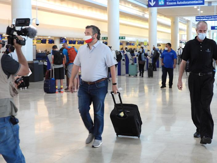 Sen. Ted Cruz (R-TX) checks in for a flight at Cancun International Airport. (Photo by MEGA/GC Images)