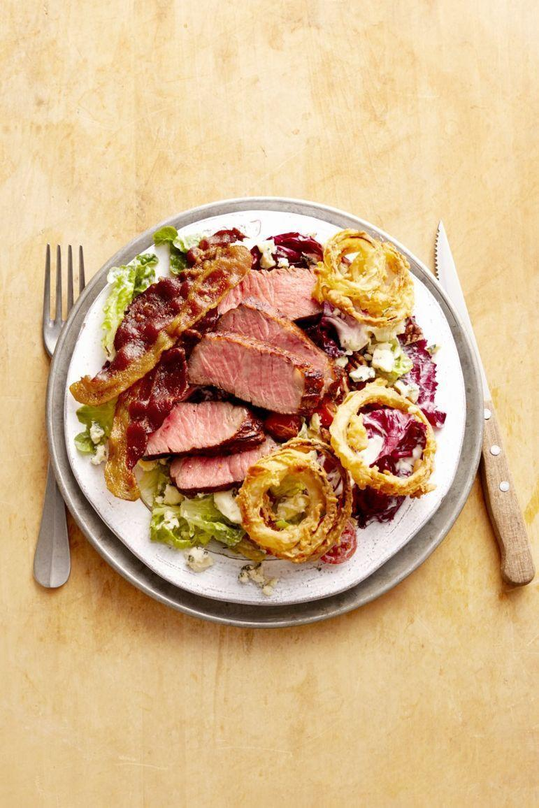 """<p>Yes, meat lovers, there really is a salad out there for you. Don't skimp on those onion rings, though!</p><p><strong><a href=""""https://www.thepioneerwoman.com/food-cooking/recipes/a32252033/steak-and-bacon-salad-with-chipotle-dressing-recipe/"""" rel=""""nofollow noopener"""" target=""""_blank"""" data-ylk=""""slk:Get the recipe"""" class=""""link rapid-noclick-resp"""">Get the recipe</a>.</strong></p><p><a class=""""link rapid-noclick-resp"""" href=""""https://go.redirectingat.com?id=74968X1596630&url=https%3A%2F%2Fwww.walmart.com%2Fbrowse%2Fhome%2Fthe-pioneer-woman-dishes%2F4044_623679_639999_7373615&sref=https%3A%2F%2Fwww.thepioneerwoman.com%2Ffood-cooking%2Fmeals-menus%2Fg35191871%2Fsteak-dinner-recipes%2F"""" rel=""""nofollow noopener"""" target=""""_blank"""" data-ylk=""""slk:SHOP DISHES"""">SHOP DISHES</a></p>"""