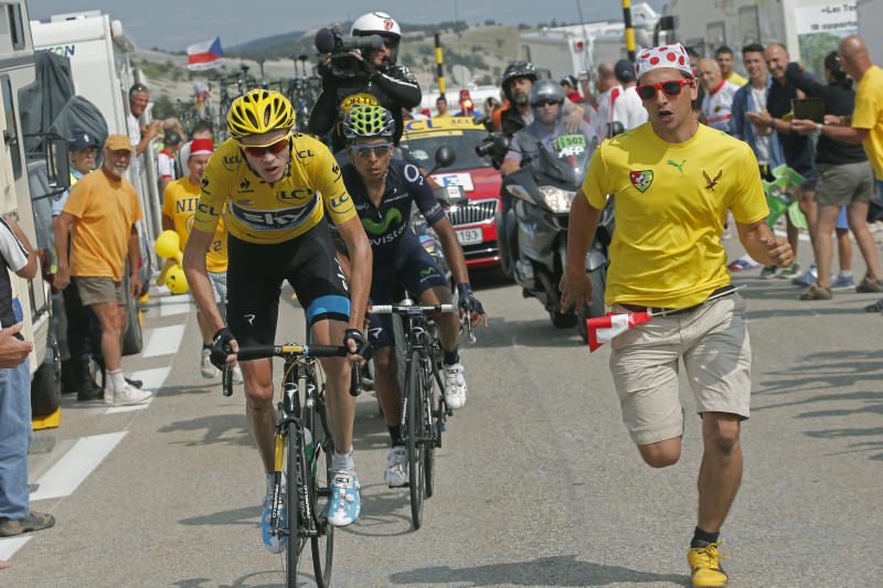 Stage winner Christopher Froome of Britain, wearing the overall leader's yellow jersey, and Nairo Alexander Quintana of Colombia climb Mont Ventoux pass during the fifteenth stage of the Tour de France cycling race over 242.5 kilometers (150.7 miles) with start in in Givors and finish on the summit of Mont Ventoux pass, France, Sunday July 14, 2013. The riders will climb to an altitude of 1912 meters (6,273 Feet) as they tackle Mont Ventoux pass at the end of the longest stage of the 100th Tour de France edition. (AP Photo/Christophe Ena)