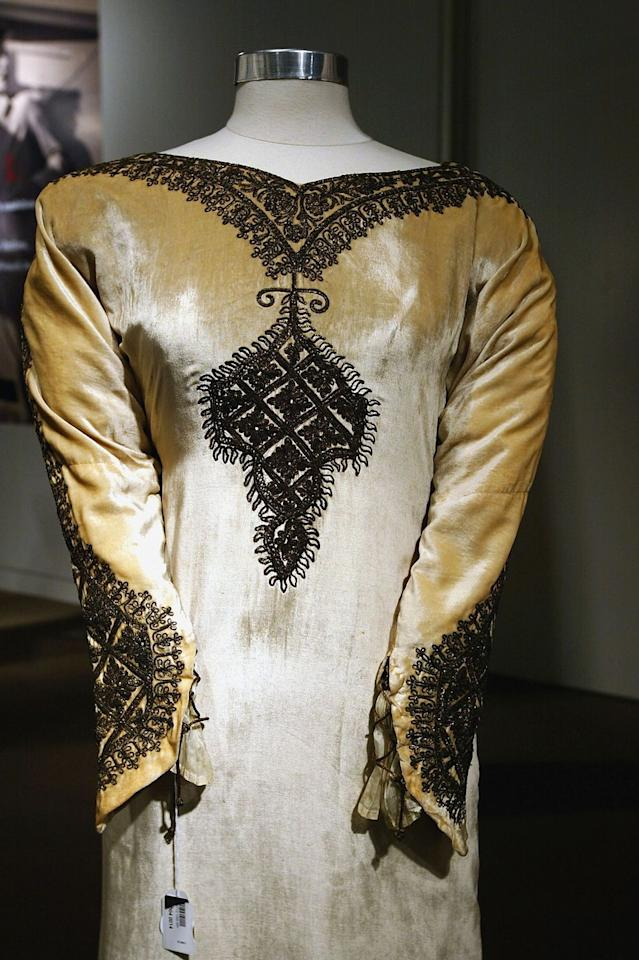 <p>Katharine Hepburn opted for an unusually ornate gown to say her vows in for her wedding to Ludlow Ogden Smith in 1928. The cream colored velvet dress with v-neck embroidery was auctioned off in 2004, amongst other items from her estate.</p>