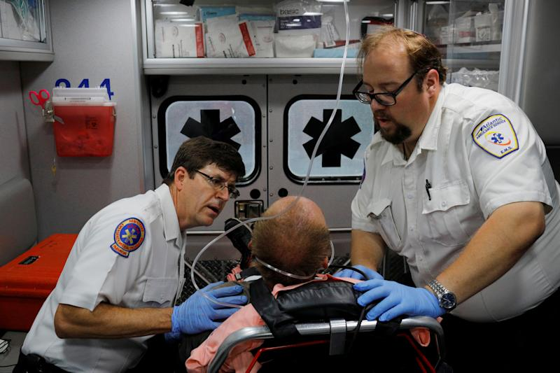 "Cataldo Ambulance medics John Gardner (L) and David Farmer care for a man in his 40's who was found unresponsive after overdosing on an opioid in the Boston suburb of Salem, Massachusetts, U.S., August 9, 2017. The victim received a total of 12mg of naloxone. Nurses at the hospital recognised the man, saying he was brought in the day before after overdosing. REUTERS/Brian Snyder SEARCH ""SNYDER OPIOIDS"" FOR THIS STORY. SEARCH ""WIDER IMAGE"" FOR ALL STORIES."